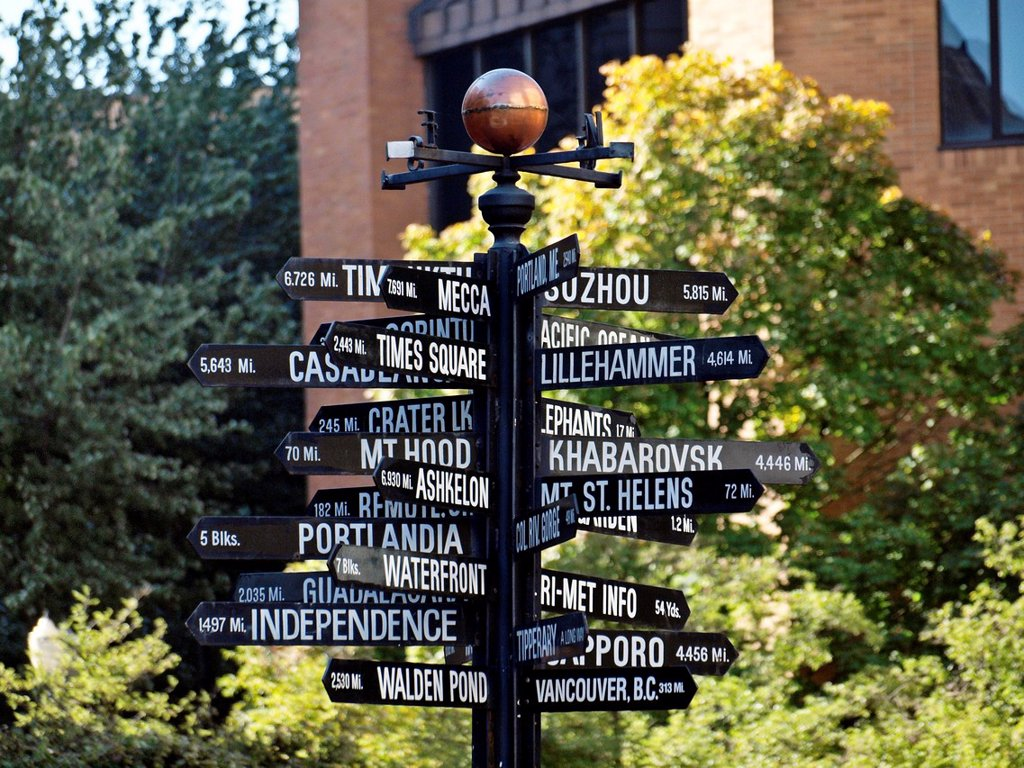 Direction sign showing distances from Pioneer Square in downtown Portland, Oregon to various places in the world : Stock Photo