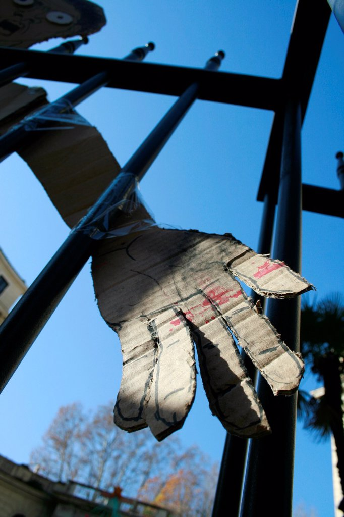 cardboard hand cutout by university college gate in rome italy : Stock Photo