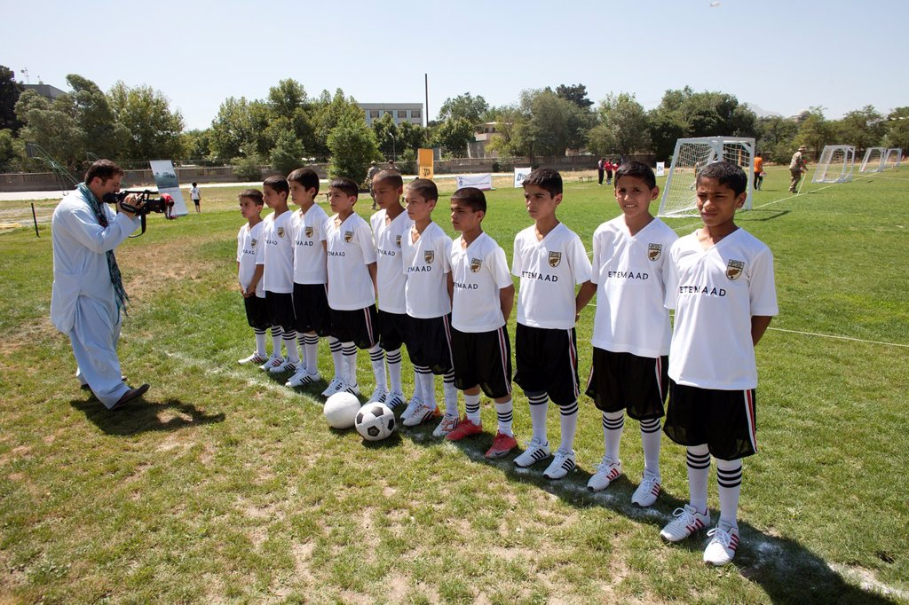 The German army organised a mini world cup tournament in Kabul for Afghan children  The teams played against each other, Turkey won the mini world cup : Stock Photo
