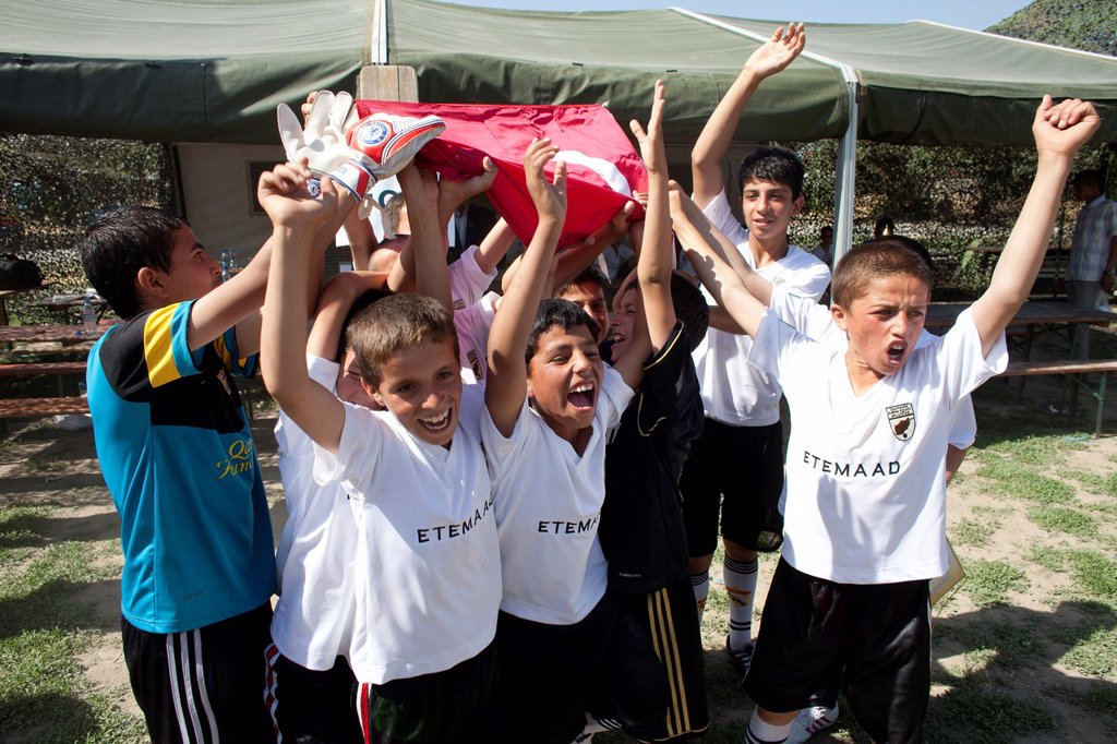 Stock Photo: 1566-1009806 The German army organised a mini world cup tournament in Kabul for Afghan children  The teams played against each other, Turkey won the mini world cup