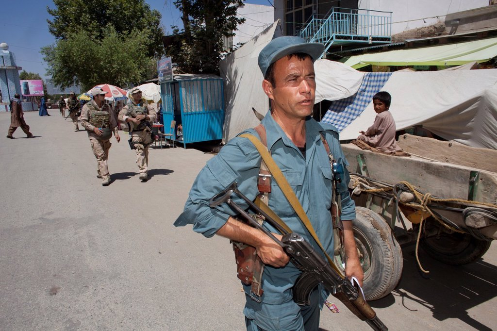 Stock Photo: 1566-1009898 Dutch police mentors walking patrol with Afghan police officers in Kunduz