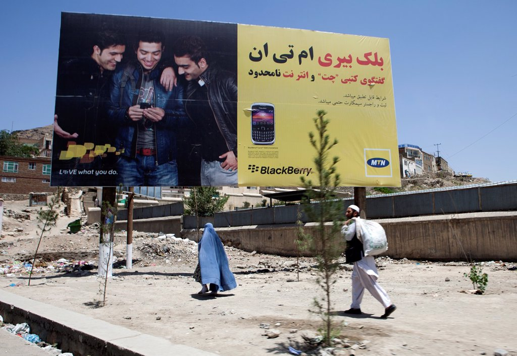 Stock Photo: 1566-1010656 billboard with mobile phone advertisement in Afghanistan