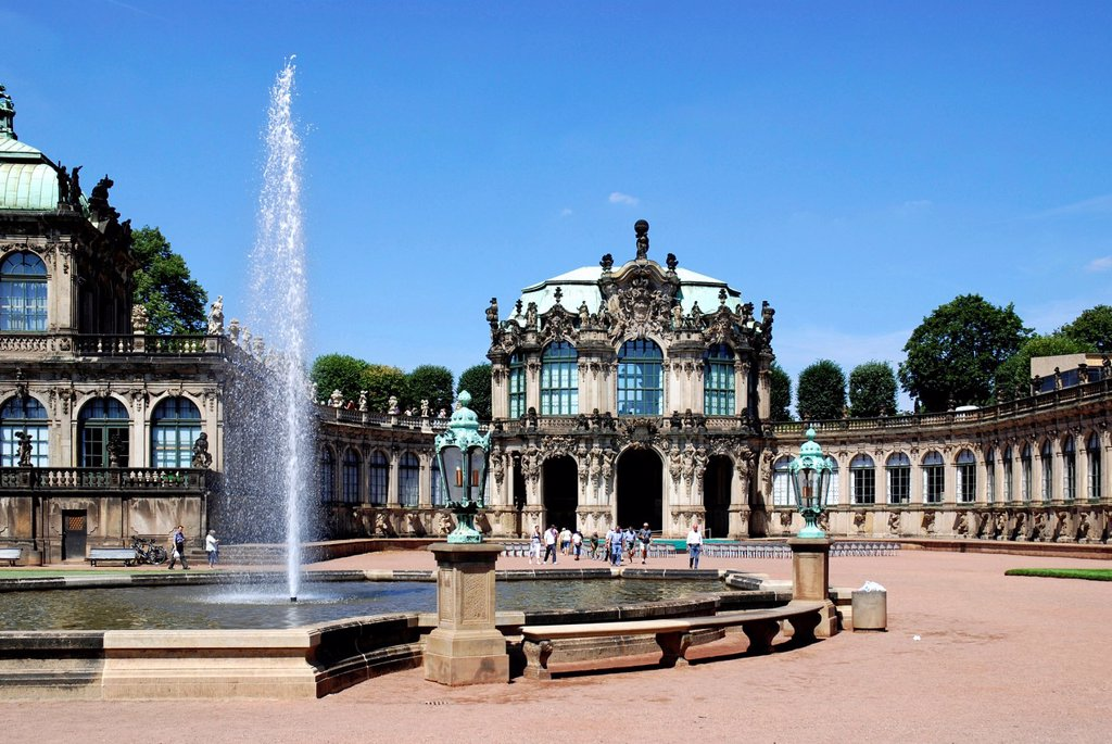 Tourists in the inner courtyard of the Zwinger in Dresden in front of the Wallpavilion in the baroque plant - Caution: For the editorial use only  Not for advertising or other commercial use! : Stock Photo