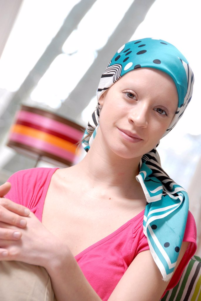 Stock Photo: 1566-1013724 Young woman wearing a hair scarf to hide her head after having loose her hair  She is having a cancer treatment