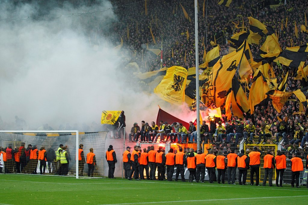 sports, football, Bundesliga, 2011/2012, Borussia Dortmund versus SC Freiburg 4:0, Stadium Signal Iduna Park in Dortmund, football fans, rampage, riots, Bengal light, rocket flare, stewards, security force : Stock Photo