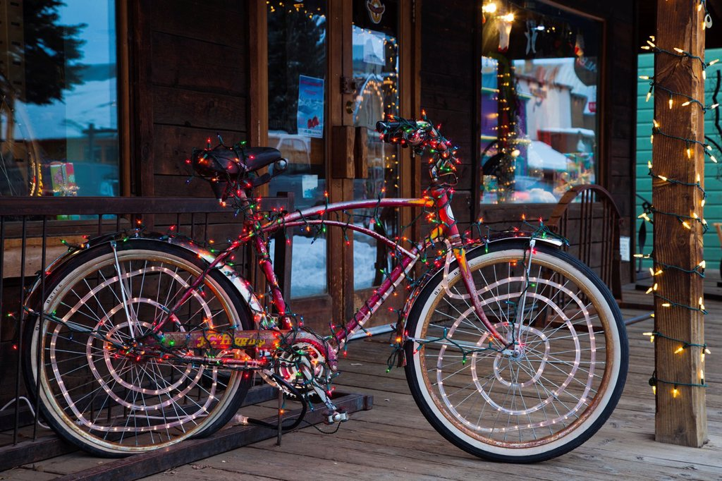 Stock Photo: 1566-1015067 USA, Colorado, Crested Butte, Elk Avenue, bicycle covered in colored lights
