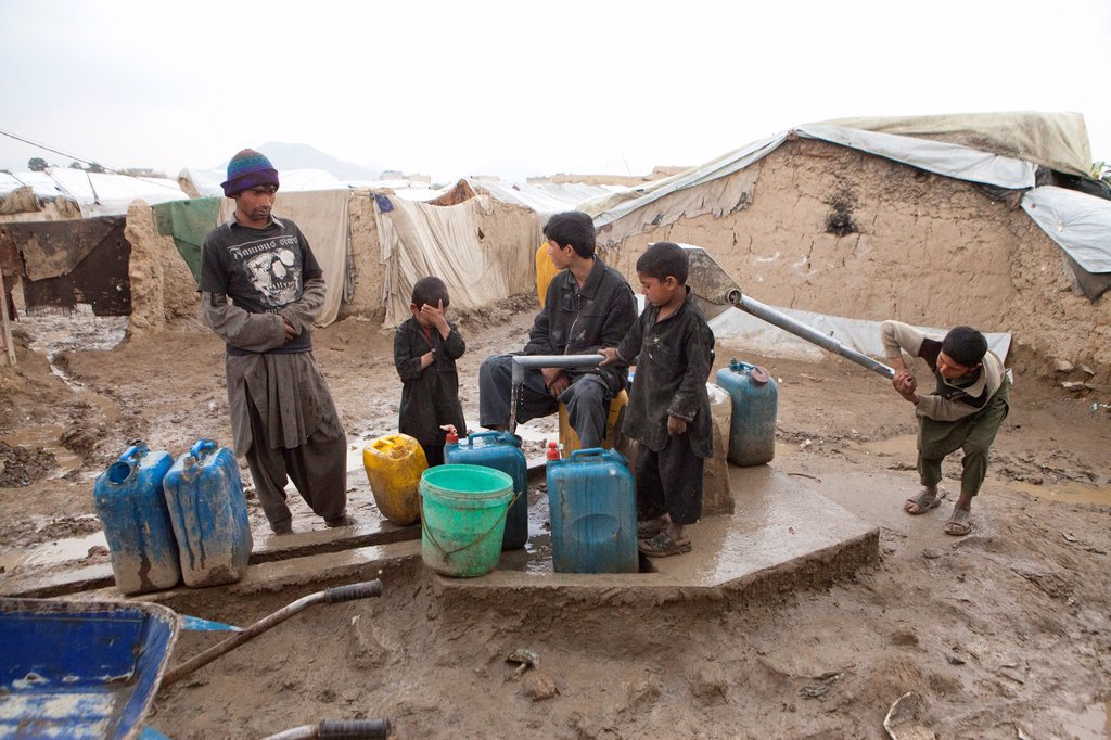 Stock Photo: 1566-1015443 waterwell in a slum in Kabul