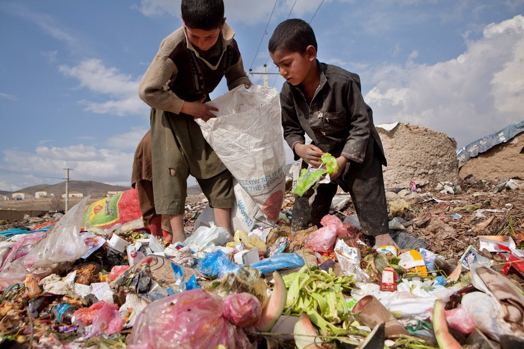 Stock Photo: 1566-1015469 many children earn an income bt collecting plastic among rubbish, Kabul,
