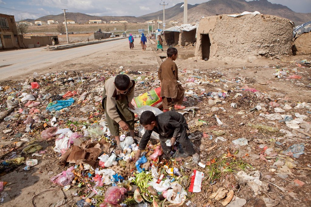 Stock Photo: 1566-1015471 many children earn an income bt collecting plastic among rubbish, Kabul,