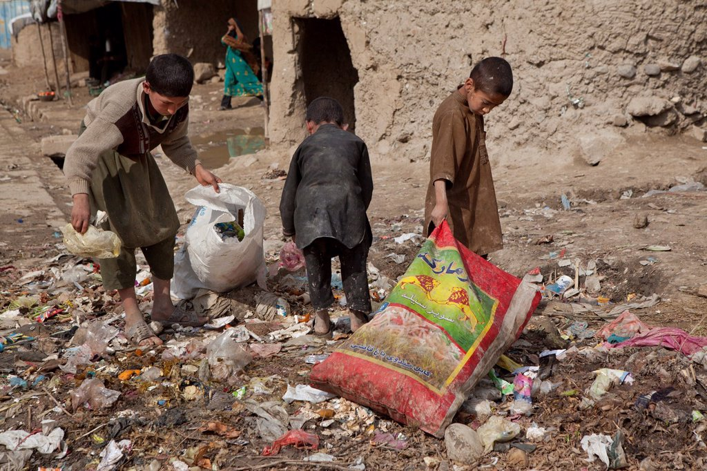 Stock Photo: 1566-1015472 many children earn an income bt collecting plastic among rubbish, Kabul,