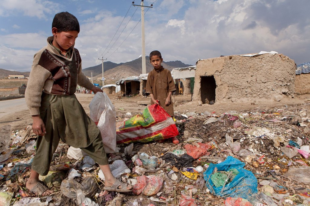 Stock Photo: 1566-1015473 many children earn an income bt collecting plastic among rubbish, Kabul,