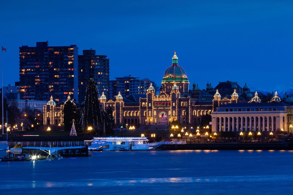 Canada, British Columbia, Vancouver Island, Victoria, Inner Harbour view towards the British Columbia Parliament Building, dusk : Stock Photo