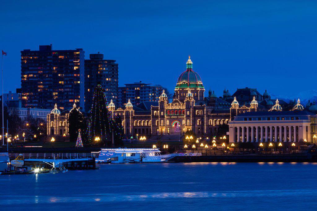 Stock Photo: 1566-1015744 Canada, British Columbia, Vancouver Island, Victoria, Inner Harbour view towards the British Columbia Parliament Building, dusk