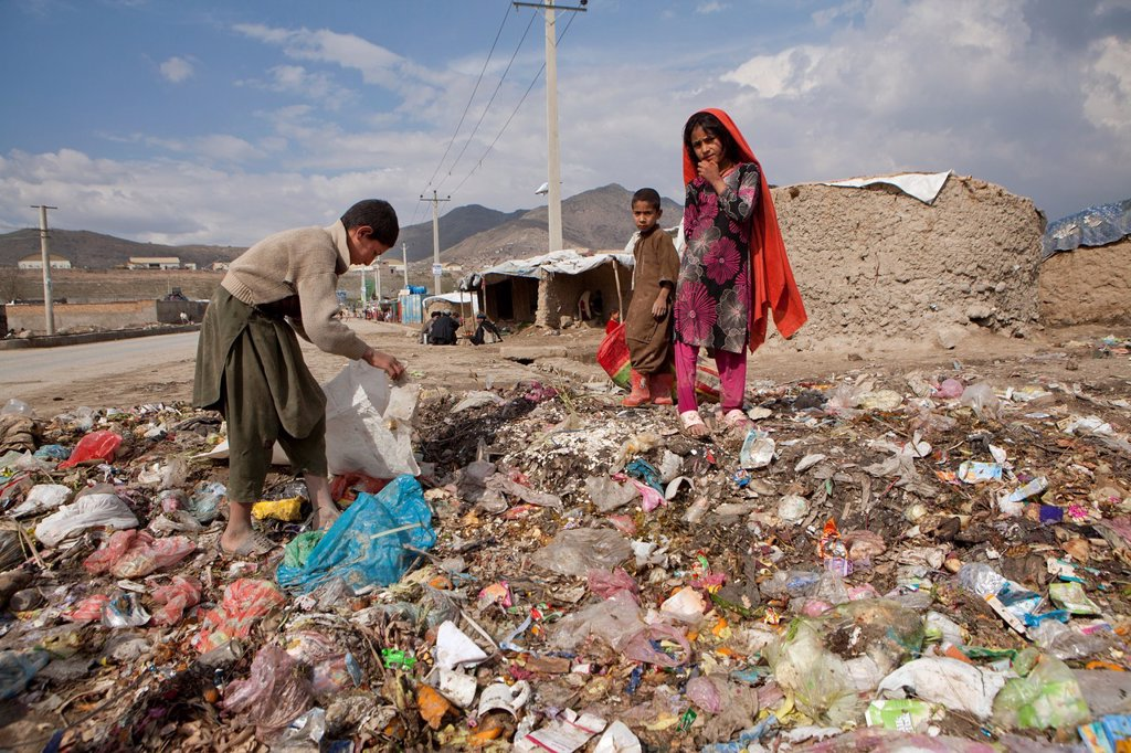 Stock Photo: 1566-1015855 many children earn an income bt collecting plastic among rubbish, Kabul,