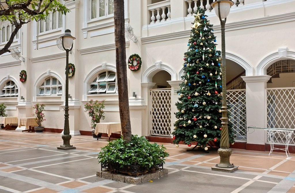 Courtyard with Christmas tree, Hotel Continental, Ho Chi Minh City, Vietnam : Stock Photo