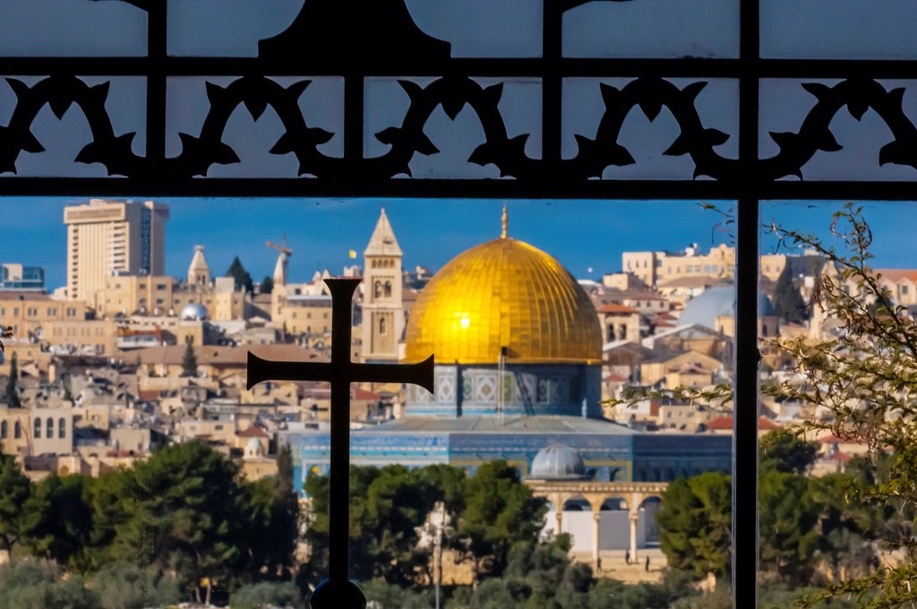 Stock Photo: 1566-1016862 The Dome on the Rock on the Temple Mount, viewed through an ornate window with a cross in the Sanctuary of Dominus Flevit Roman Catholic church on the Mount of Olives, Jerusalem, Israel