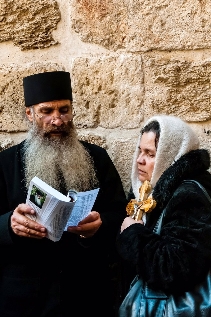 Stock Photo: 1566-1016983 Armenian Orthodox priest outside the Church of the Holy Sepulchure also called the Church of the Resurrection, the Christian Quarter of the Old City, Jerusalem, Israel