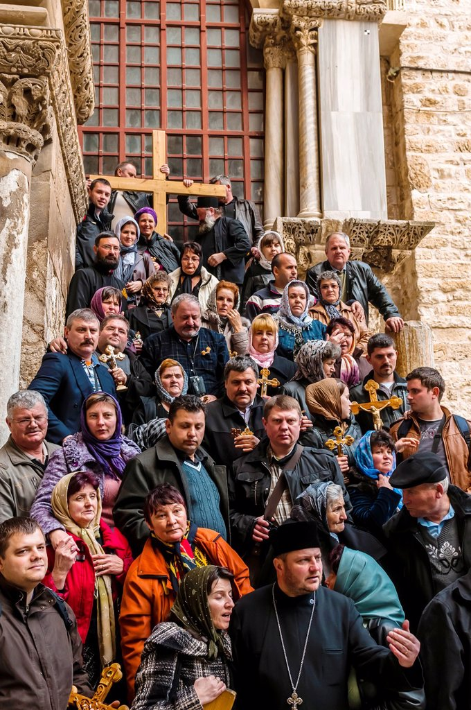 Stock Photo: 1566-1016985 Armenian pilgrims outside the Church of the Holy Sepulchre site of the last five stations of the Cross and venerated as the place where Jesus was crucified and buried, the Christian Quarter, Old City, Jerusalem, Israel