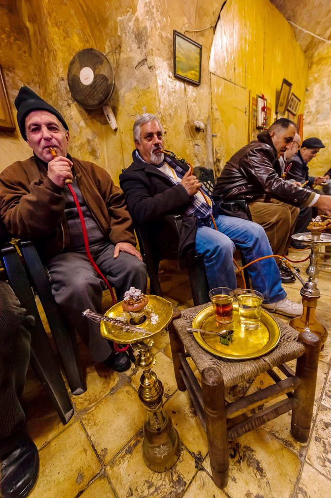 Men smoking sheesha water pipe in a cafe in the Arab Souk in the Old City, Jerusalem, Israel : Stock Photo