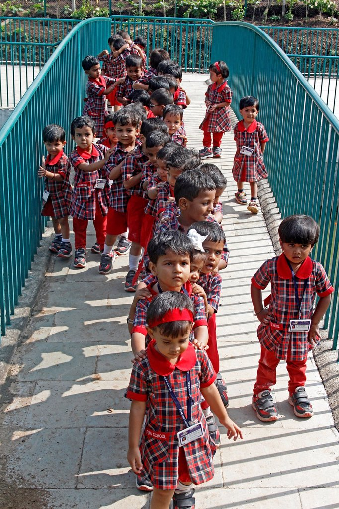 children playing in schoolyard, aaryan school, pune, maharashtra, india : Stock Photo