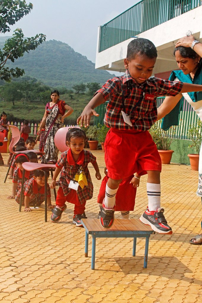 Stock Photo: 1566-1018833 children playing in schoolyard, aaryan school, pune, maharashtra, india