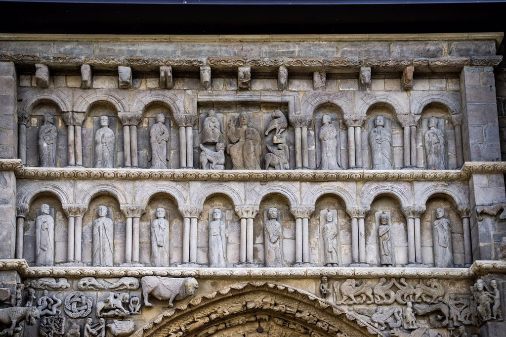 Stock Photo: 1566-1019210 Christ in Majesty, flanked by symbols of Evangelistas, and by Apostoles. Detail of main portal of Romanesque Church Santa María la Real in medieval town Sangüesa in Navarre, Spain.