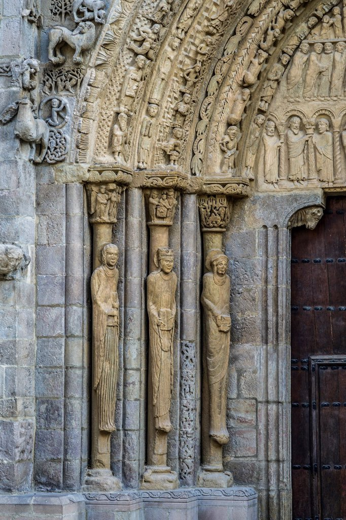 Stock Photo: 1566-1019211 Columns depicting figures of Maria Magdalena, Virgen Maria and Maria mother of Santiago and Juán. Detail of main portal of Romanesque Church Santa María la Real in medieval town Sangüesa in Navarre, Spain
