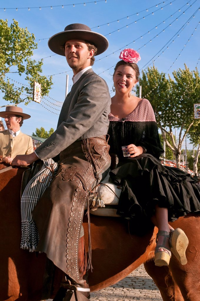Stock Photo: 1566-1019232 April Fair  Couple in traditional costumes on a horse  Sevilla  Spain