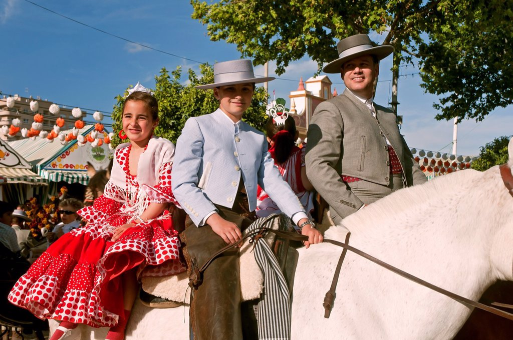 Stock Photo: 1566-1019237 April Fair  Family with traditional costumes, on horseback  Sevilla  Spain