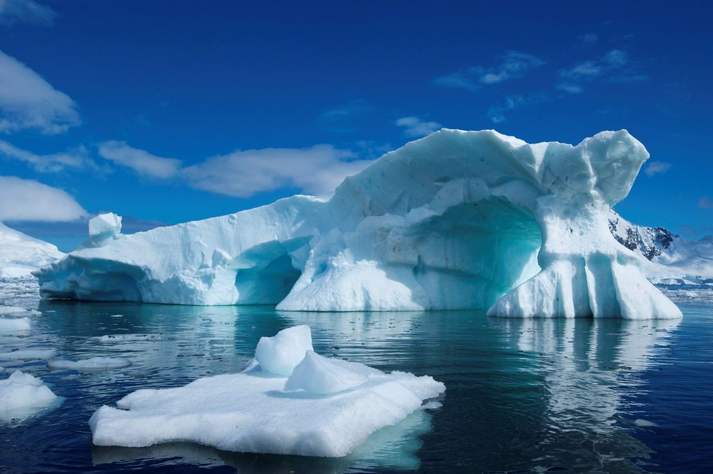 An iceberg reminiscent of Peter Pan´s Skull Rock floats in Skontorp Cove on the Antarctic Penninsula. : Stock Photo