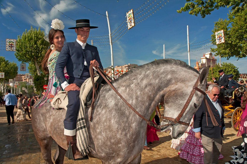 Stock Photo: 1566-1019675 April Fair  Couple in traditional costumes on a horse  Sevilla  Spain