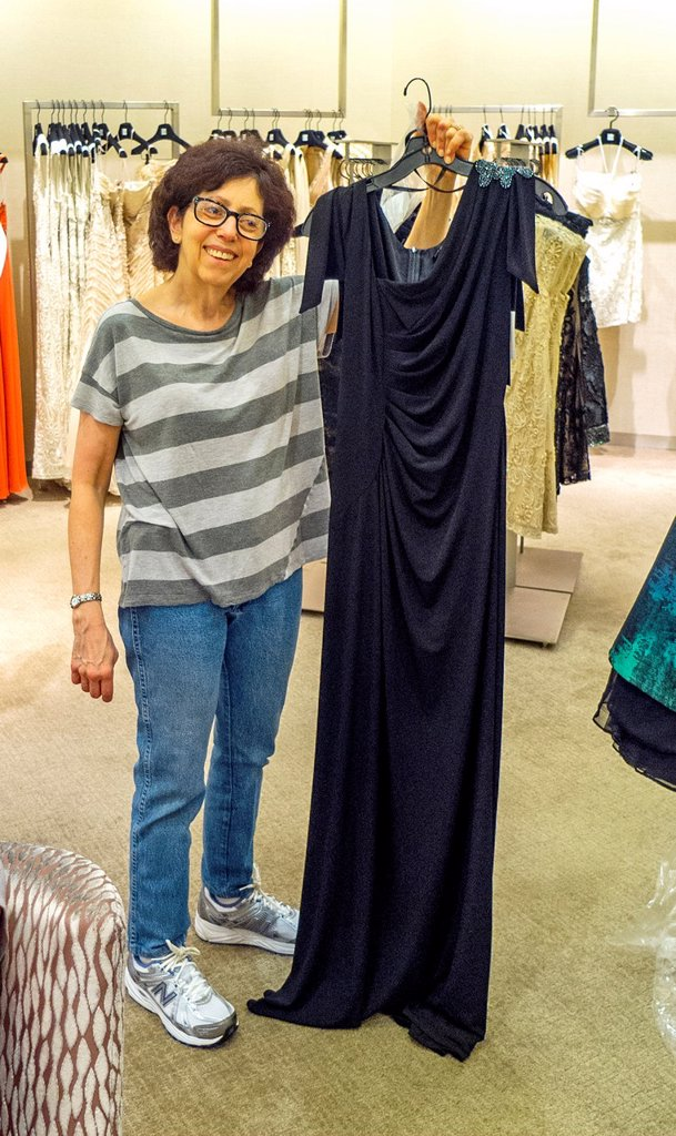 Stock Photo: 1566-1020181 At Saks Fifth Avenue specialty store in New York, a happy mother buys a gown to wear at her daughter´s wedding