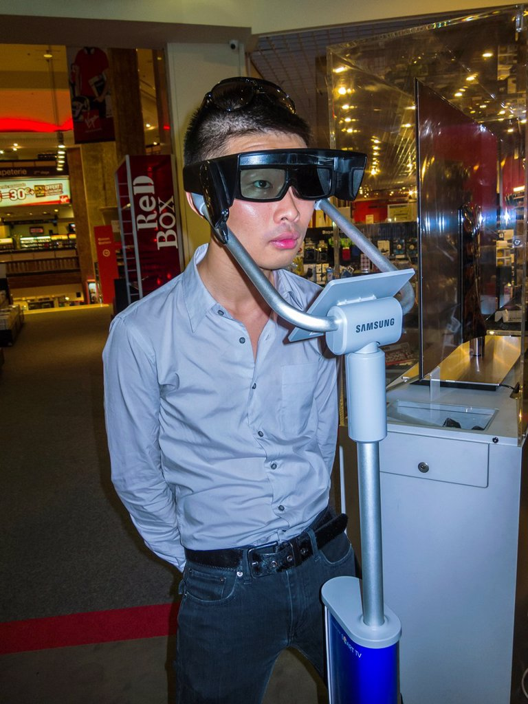 Paris, France, Chinese Man Using Three Dimensional Glasses 3D for High Definition T V  in VIrgin Store, Shopping on the Avenue Champs Elysees Model Released : Stock Photo
