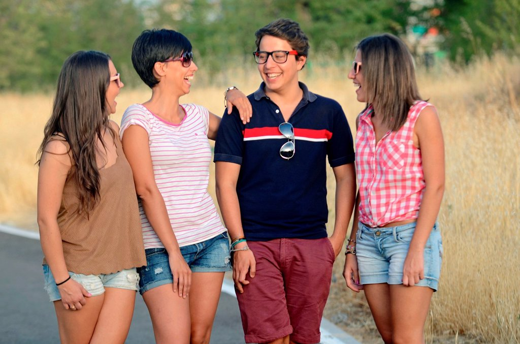 Stock Photo: 1566-1021027 Group of three young women and a man have fun outdoors
