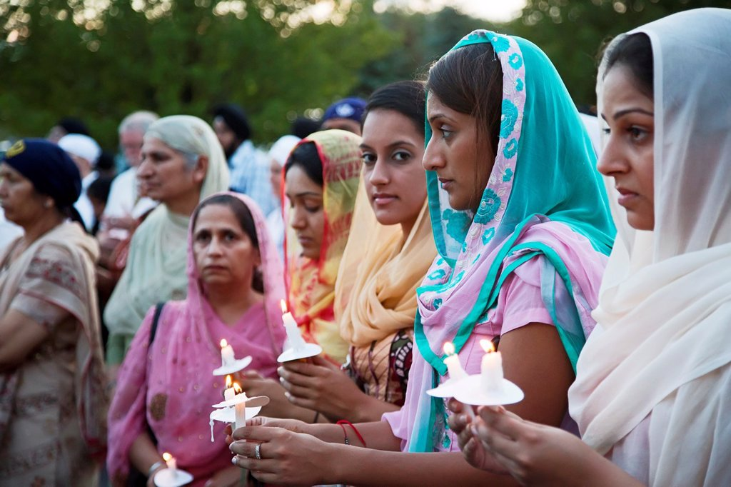 Stock Photo: 1566-1023080 Plymouth, Michigan - Hundreds of Detroit-area Sikhs held a memorial service and candlelight vigil at the Hidden Falls Gurdwara temple for victims of the Wisconsin shooting  Six Sikhs were killed during a religious service at a temple near Milwaukee by Wad. Plymouth, Michigan - Hundreds of Detroit-area Sikhs held a memorial service and candlelight vigil at the Hidden Falls Gurdwara temple for victims of the Wisconsin shooting  Six Sikhs were killed during a religious service at a temple near Milw