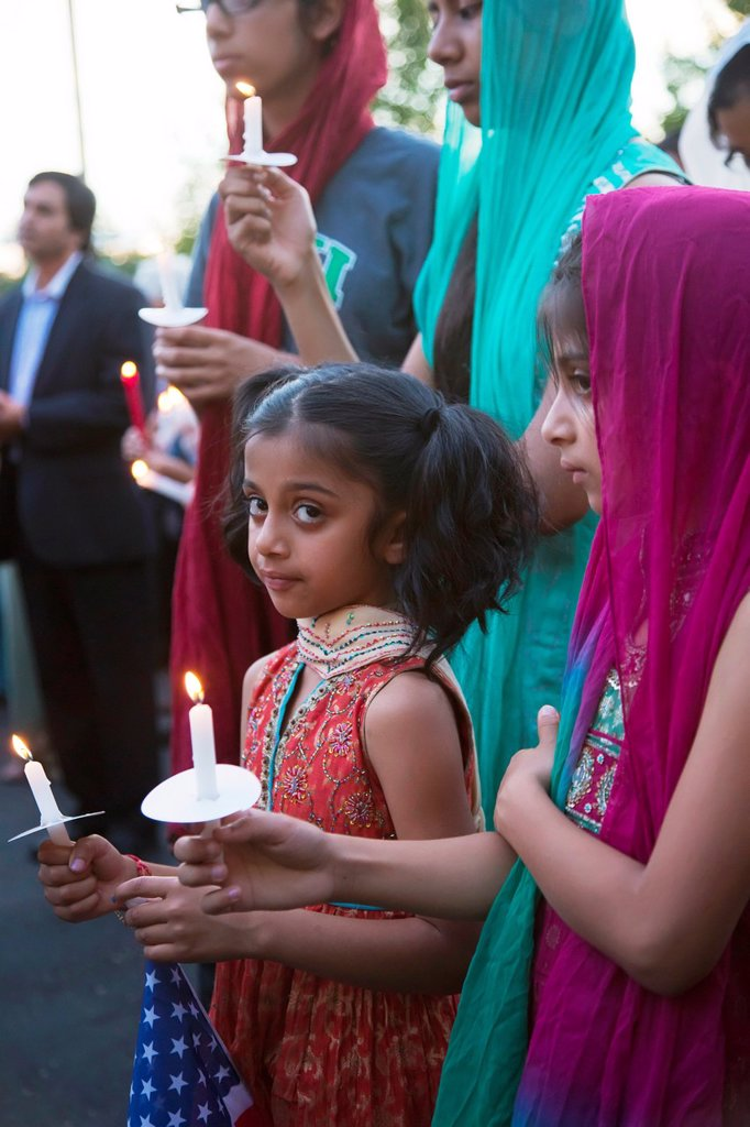 Stock Photo: 1566-1023090 Plymouth, Michigan - Hundreds of Detroit-area Sikhs held a memorial service and candlelight vigil at the Hidden Falls Gurdwara temple for victims of the Wisconsin shooting  Six Sikhs were killed during a religious service at a temple near Milwaukee by Wad. Plymouth, Michigan - Hundreds of Detroit-area Sikhs held a memorial service and candlelight vigil at the Hidden Falls Gurdwara temple for victims of the Wisconsin shooting  Six Sikhs were killed during a religious service at a temple near Milw