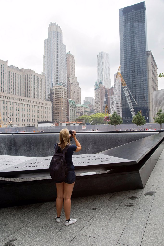 Stock Photo: 1566-1023097 New York, NY - The 9/11 Memorial, commemorating the September 11, 2001 attacks on the World Trade Center and the Pentagon  The focus of the memorial is two pools constructed on the locations where the twin World Trade Center towers stood
