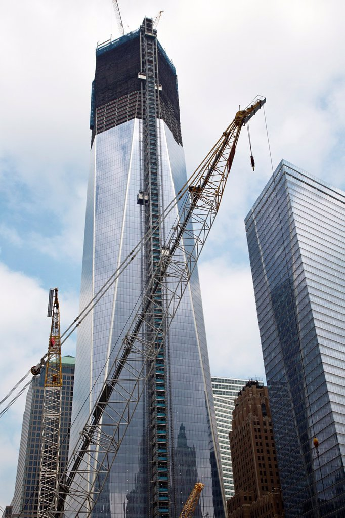 Stock Photo: 1566-1023299 New York, NY - Construction of the new 1 World Trade Center office tower to replace the towers destroyed in the September 11, 2001 terrorist attack  When finished, it will be the tallest building in the United States