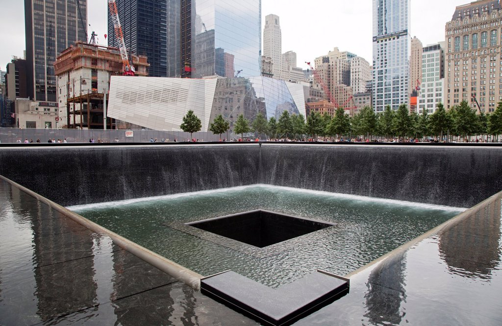 New York, NY - The 9/11 Memorial, commemorating the September 11, 2001 attacks on the World Trade Center and the Pentagon  The focus of the memorial is two pools constructed on the locations where the twin World Trade Center towers stood : Stock Photo