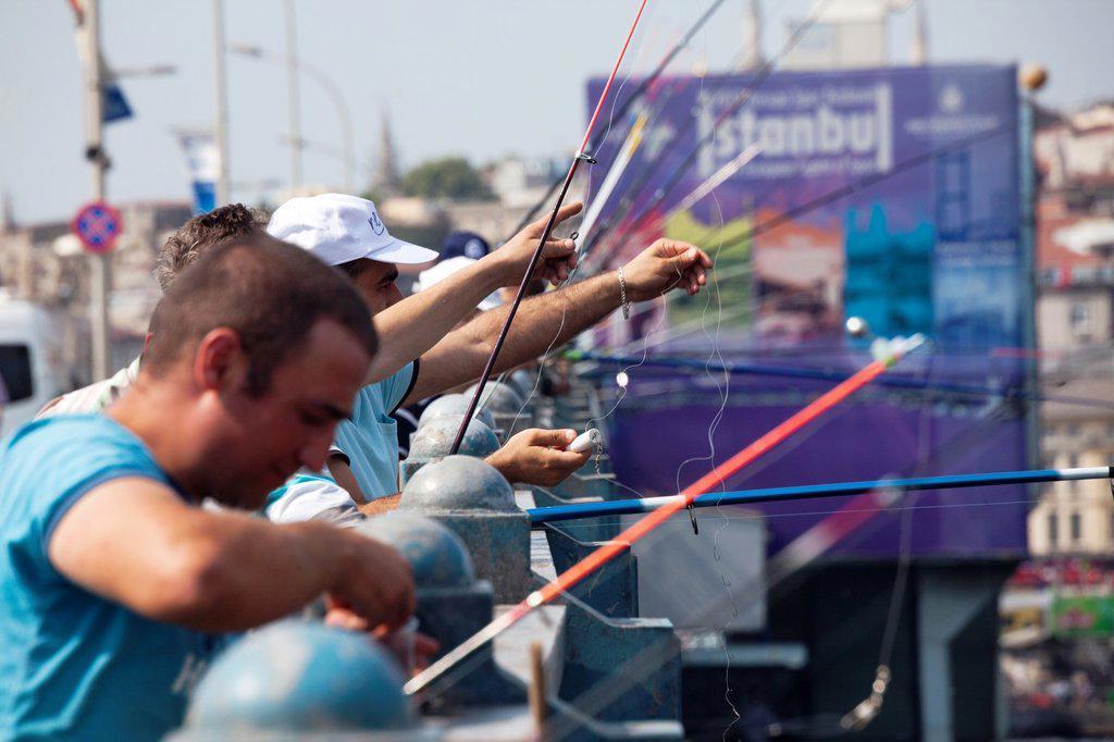 Stock Photo: 1566-1023870 fishing from the galata bridge, istanbul