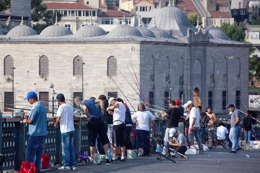 fishing from the galata bridge, istanbul : Stock Photo