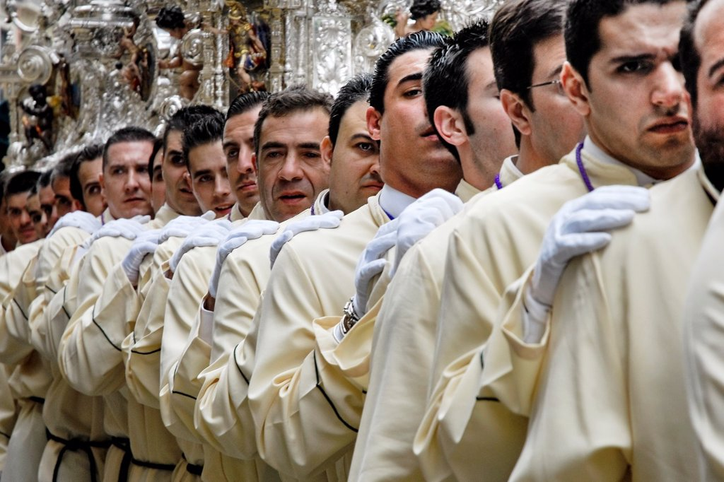 Stock Photo: 1566-1024812 The silver-coated throne is carried on the shoulders of the carriers during the Easter celebration in Malaga, Spain, 2 April 2007