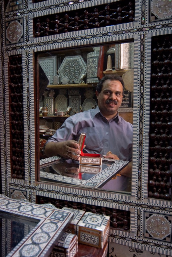 Stock Photo: 1566-1025292 Artisan Nabil El Tablawy with his products in mother of pearl, Khan Al Khalili Bazaar, , Cairo, Egypt, North Africa, Africa