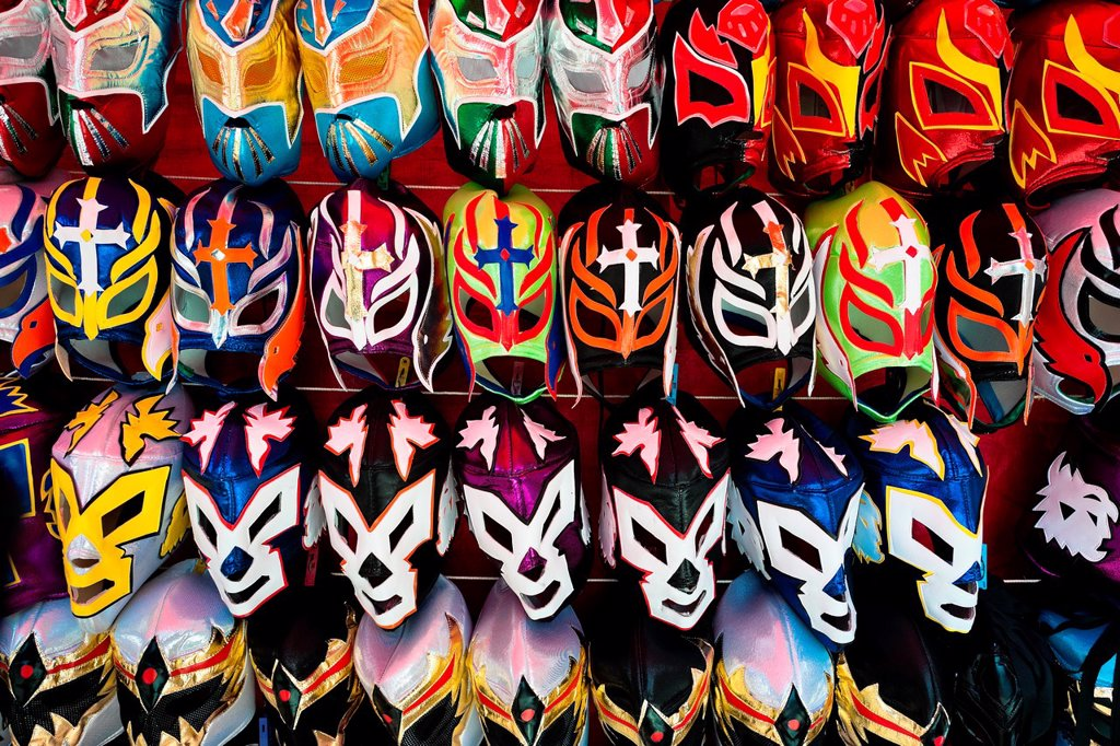Stock Photo: 1566-1027205 Colorful Lucha libre Mexican wrestling masks, inspired by those worn by professional wrestlers, for sale in a street shop in Mexico City, Mexico, 29 May 2011  Lucha Libre, 'free wrestling', is a unique Mexican sporting event characterized by the use of co. Colorful Lucha libre Mexican wrestling masks, inspired by those worn by professional wrestlers, for sale in a street shop in Mexico City, Mexico, 29 May 2011  Lucha Libre, 'free wrestling', is a unique Mexican sporting event characterized by t