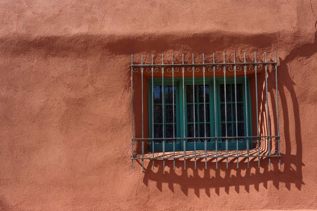 Spanish-style grilled window on adobe house, Santa Fe, New Mexico, USA : Stock Photo