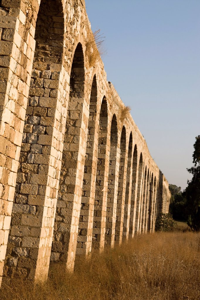 Stock Photo: 1566-1027707 OLD OTTOMAN TURKISH AQUADUCT LOHAMEI HAGETAOTT KIBBUTZ ACCO ISRAEL