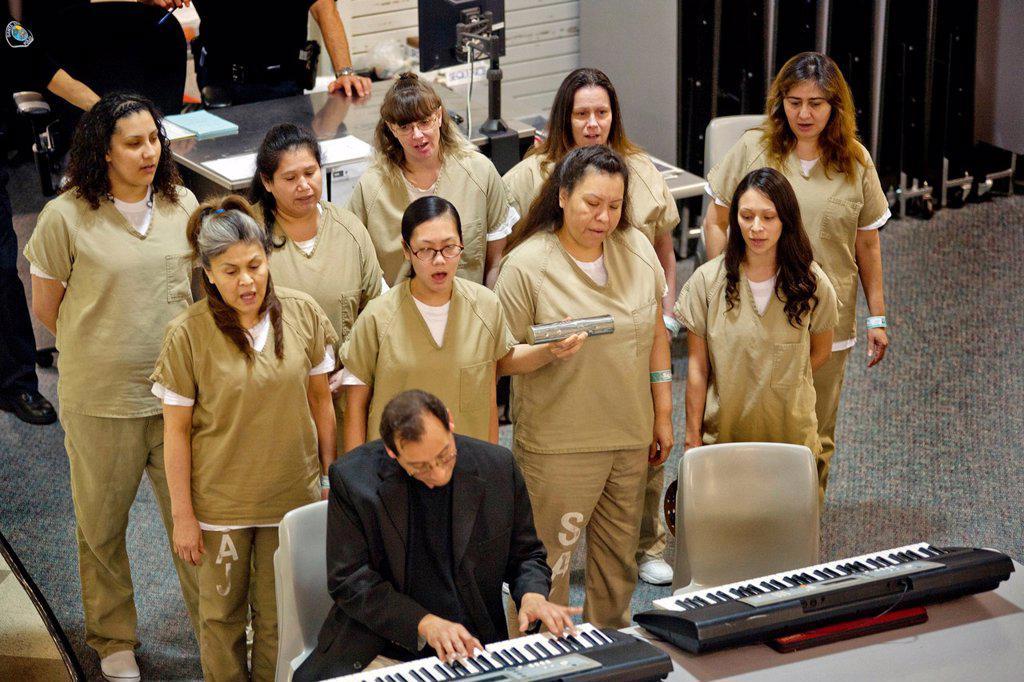 Stock Photo: 1566-1028549 A choir of female inmates at the Santa Ana, CA city jail sings at graduation of a jail educational program