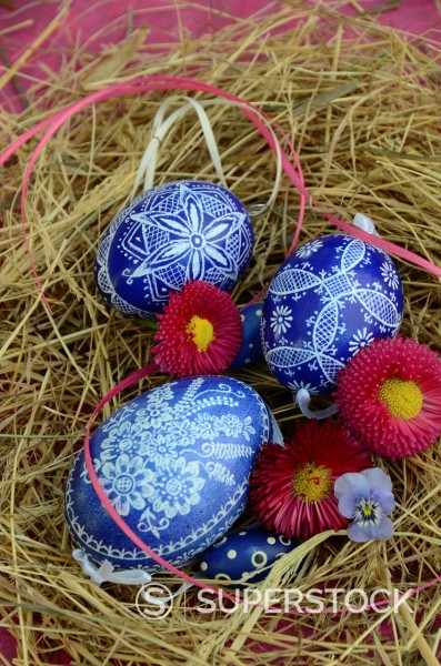 Colorful Easter Eggs resting in Hay : Stock Photo