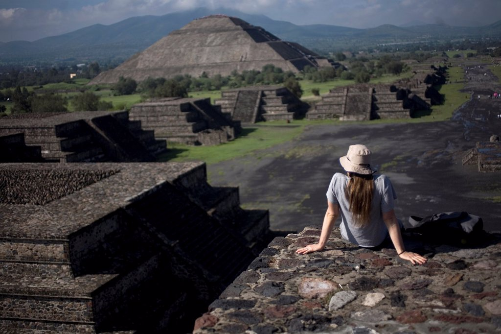 "Stock Photo: 1566-1031200 A woman looks at the Pyramid of the Sun, back left, from the Pyramid of the Moon in Teotihuacan, Mexico City Teotihuacan that means ""City of the Gods´ and was founded by the Teotihuacanos around 500 BC and reach its peak some time around 500 AD A legend s. A woman looks at the Pyramid of the Sun, back left, from the Pyramid of the Moon in Teotihuacan, Mexico City Teotihuacan that means ""City of the Gods´ and was founded by the Teotihuacanos around 500 BC and reach its peak some time around 500 A"