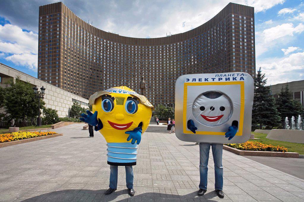 Stock Photo: 1566-1032154 Men doing advertisement, ´Kosmos´ hotel , Moscow, Russia.